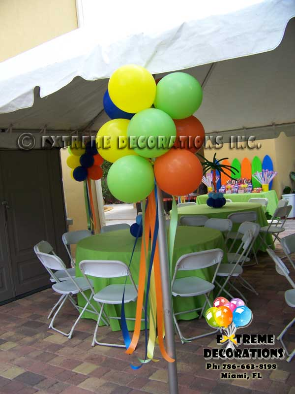 Balloon pom poms for tent leg decoration