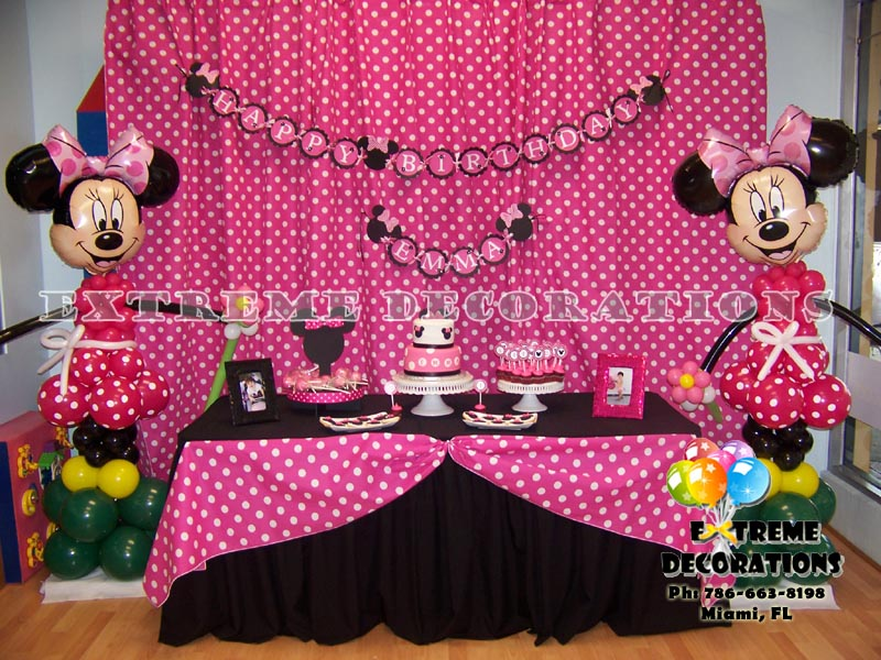 Pink Minnie cake table decoration with backdrop polka dots