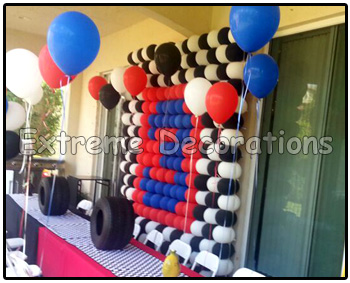 Party decorations miami balloon walls for Balloon decoration cars theme